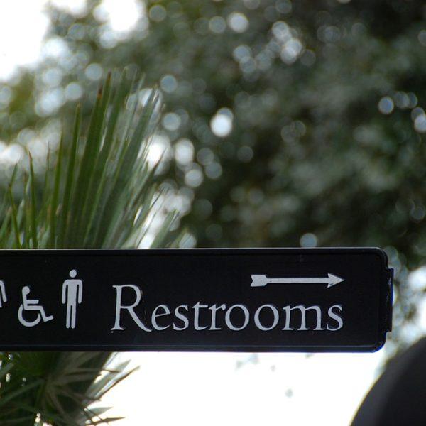 urine leakage treatment Delhi, restroom sign