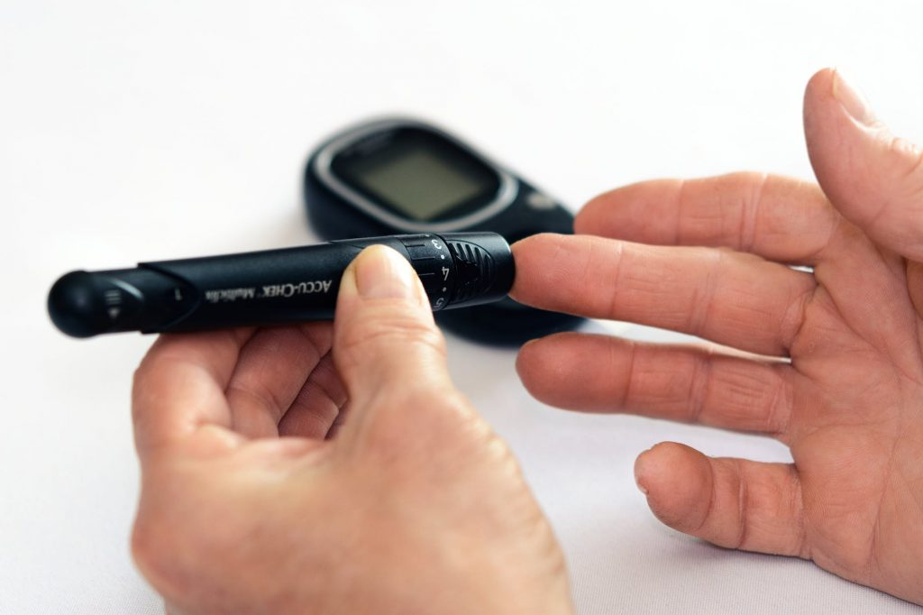 Person checking blood sugar levels, relationship between diabetes and erectile dysfunction